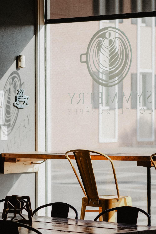 brown chair facing glass wall