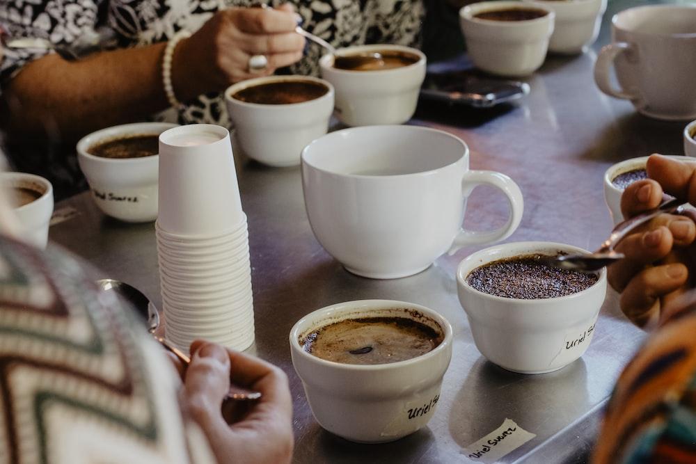 white mugs on table
