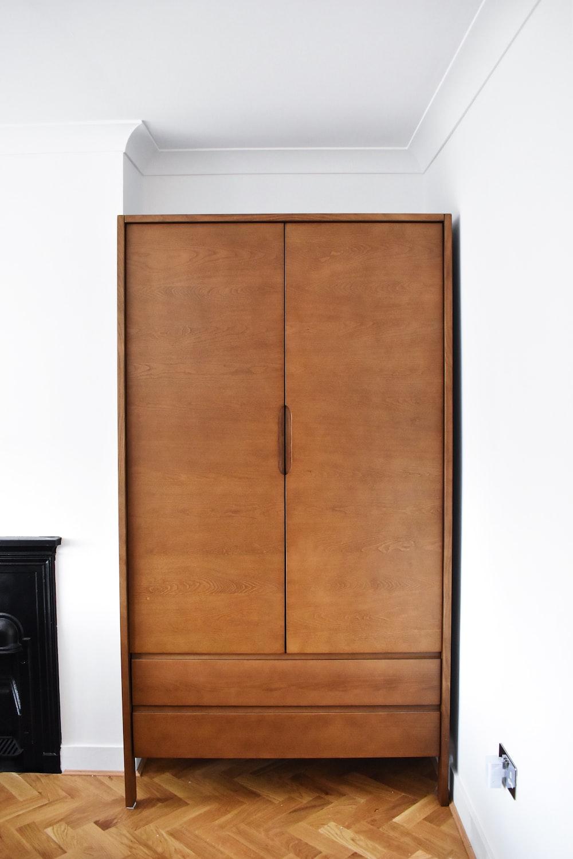 brown wooden 2-door cabinet