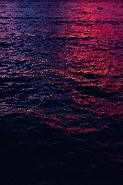 purple light through body of water
