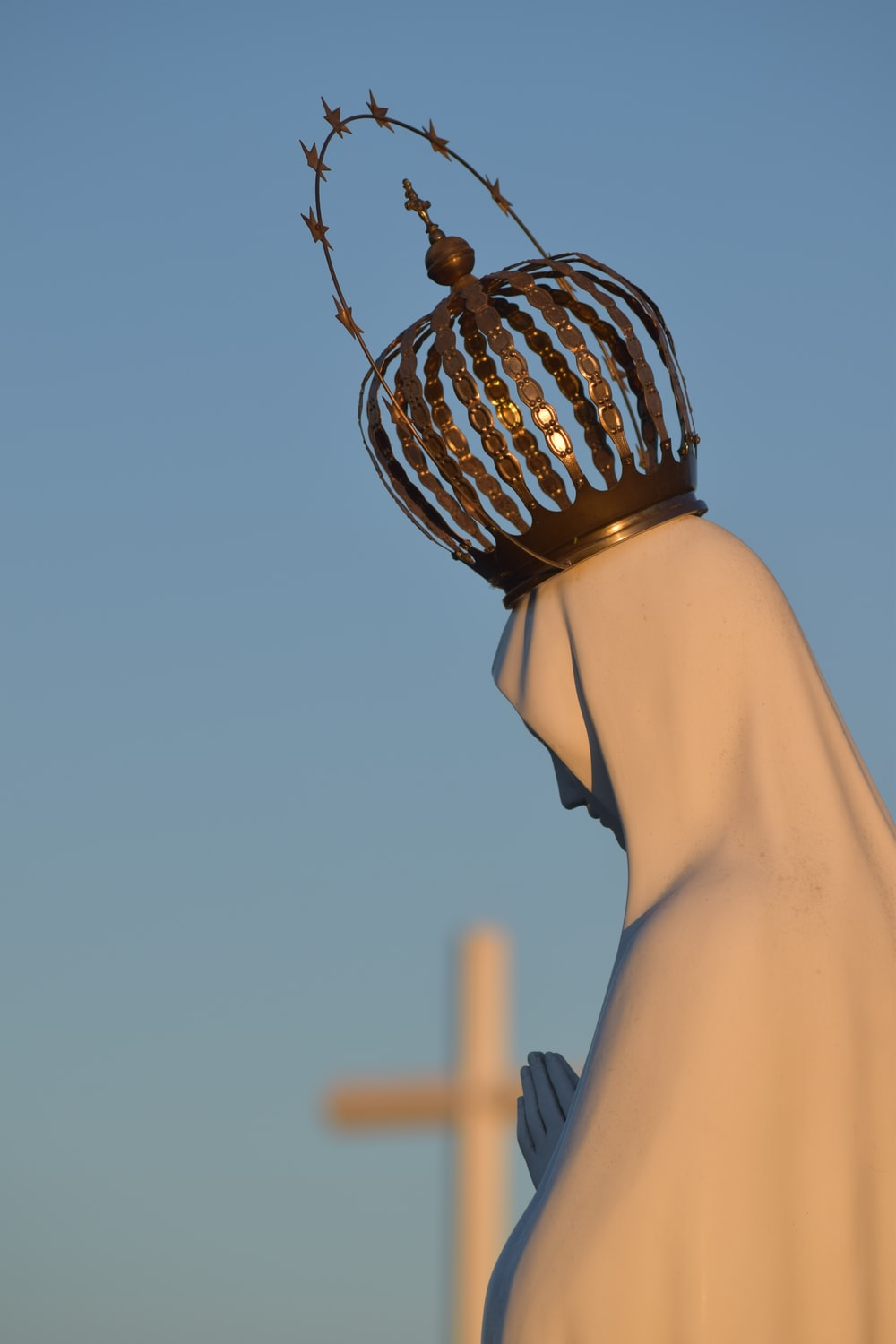 white Virgin Mary statue with gold crown