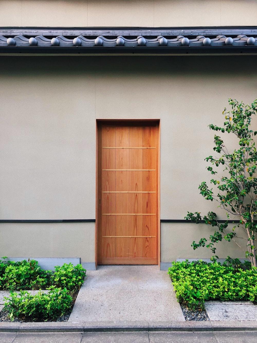 brown wooden door is close during daytime