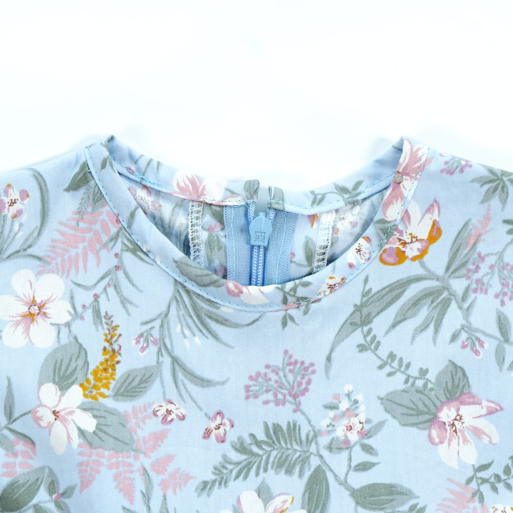 teal, pink, and green floral crew-neck top