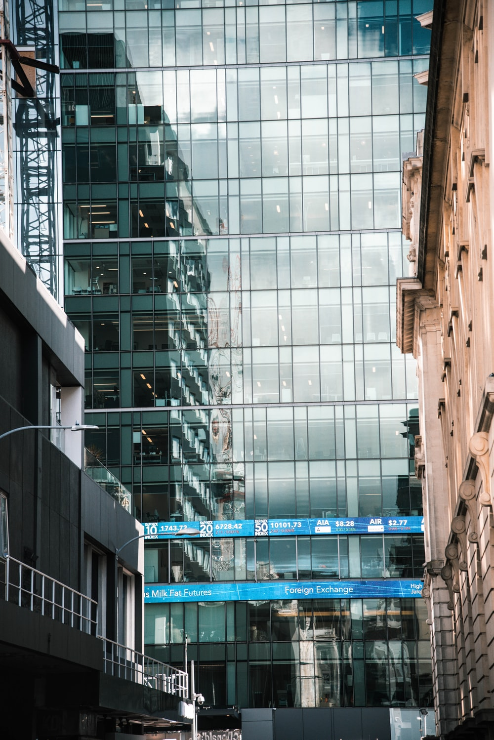 clear glass paneled high rise building