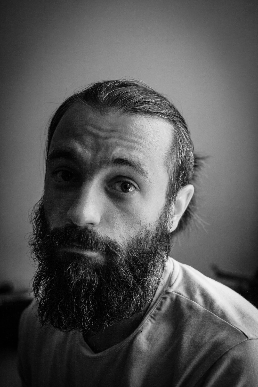 grayscale photography of man wearing shirt