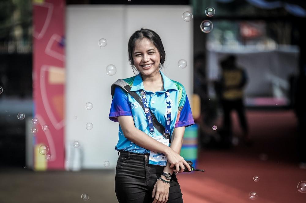 smiling girl standing near building
