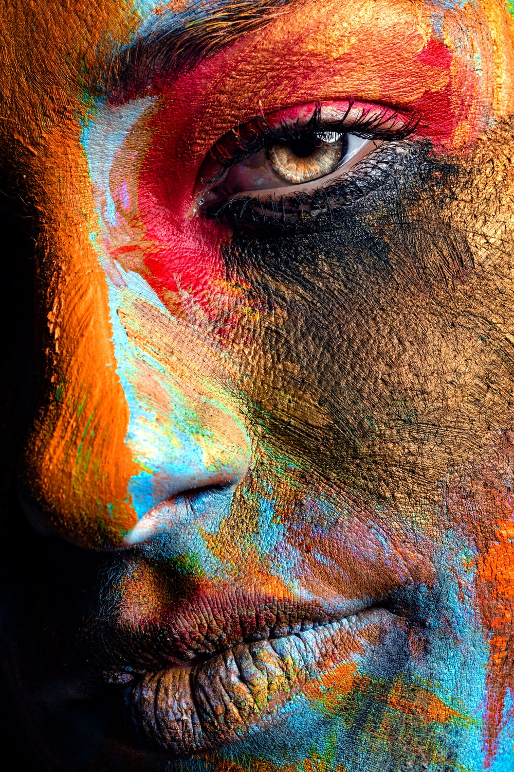 person face covered with paint
