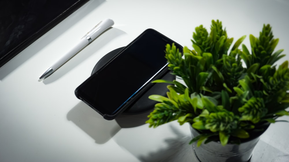 smartphone place on wireless charger on table