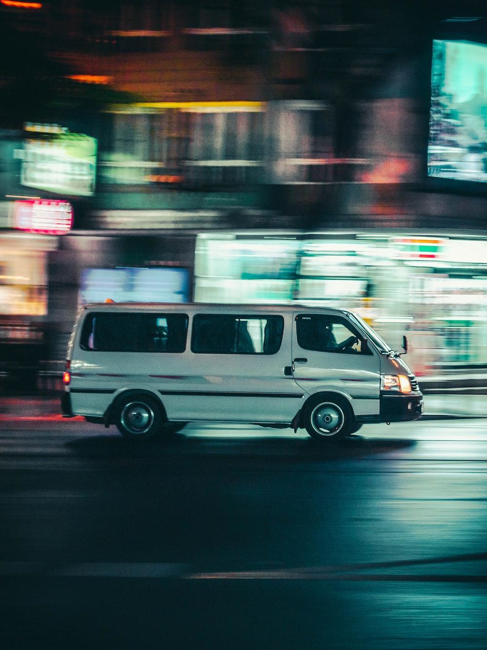white van running on road
