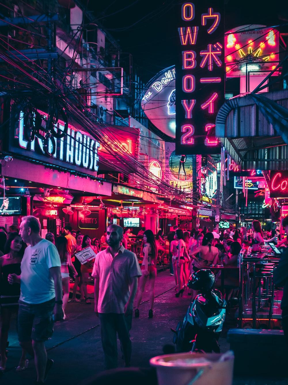 woman wearing bikinis in alley during night time