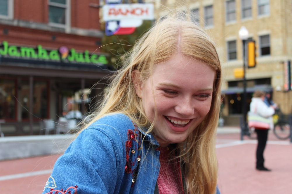 smiling woman beside street