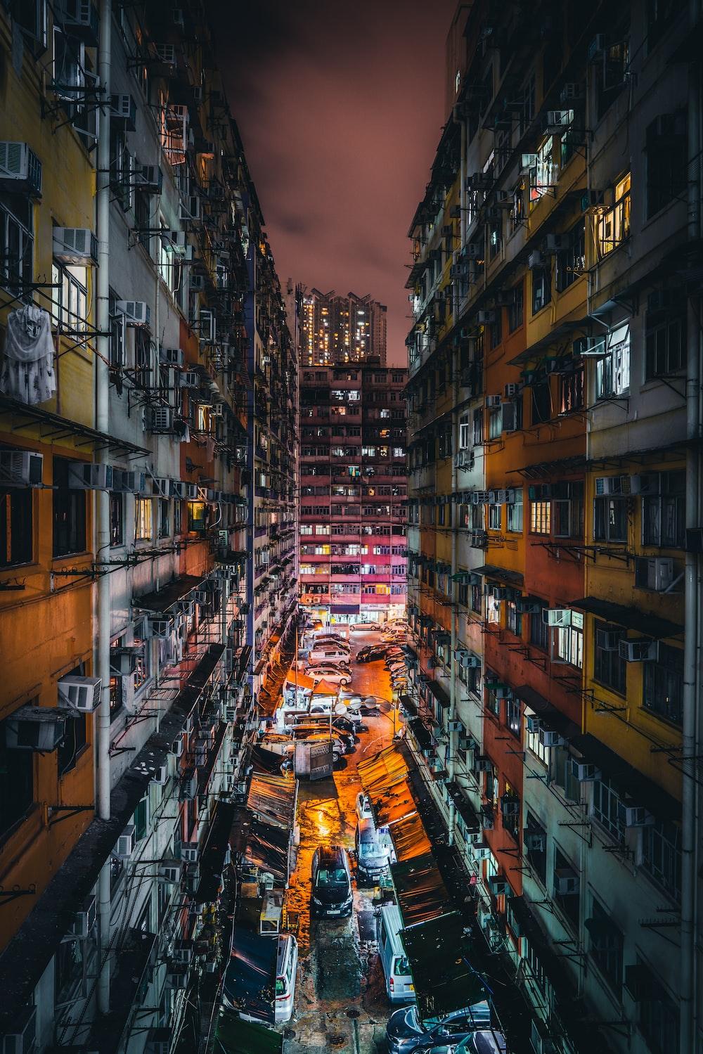 vehicles in between two buildings