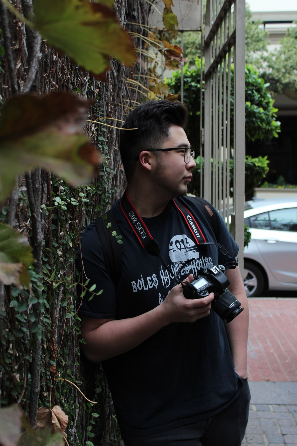 man standing while holding DSLR camera