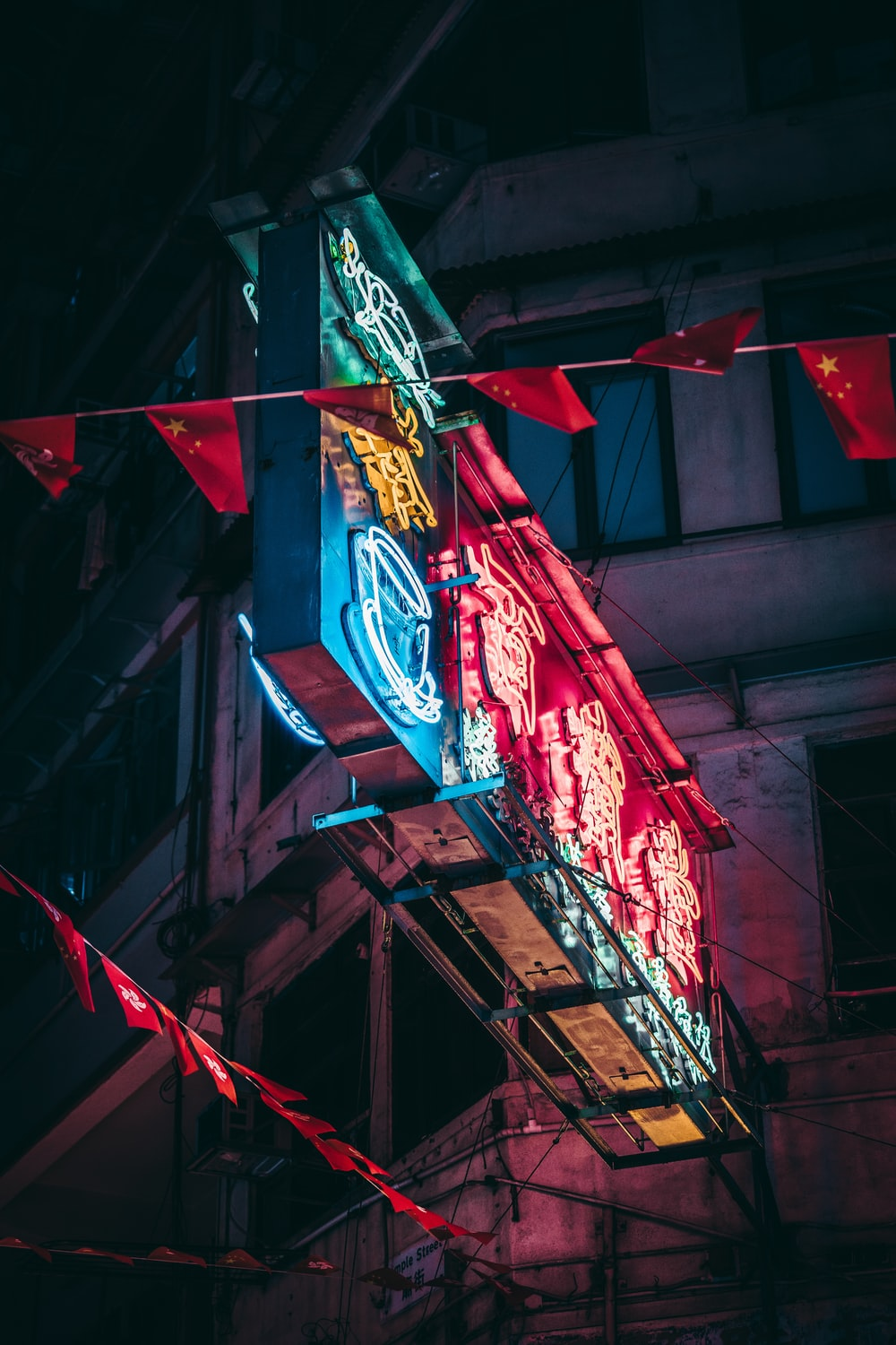 rectangular blue and red wooden stand during night time