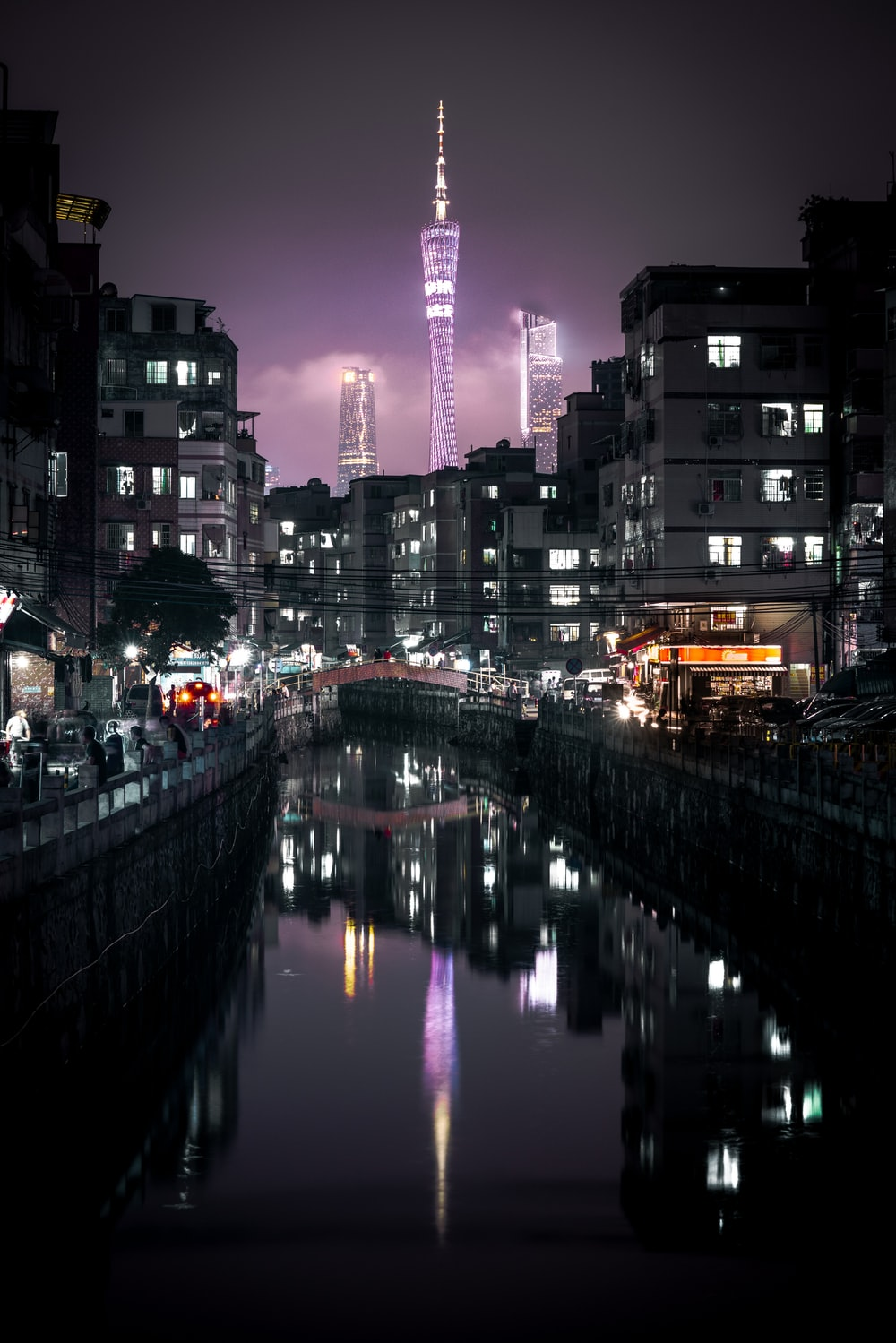 buildings reflected on water at night
