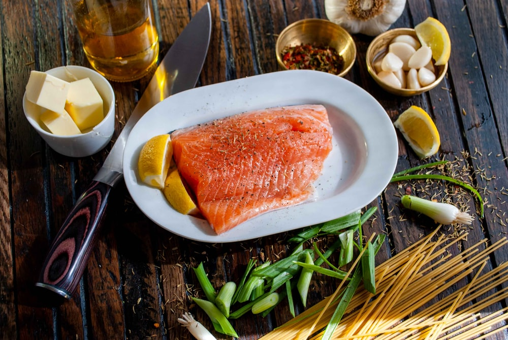 flat lay photography of raw salmon fish