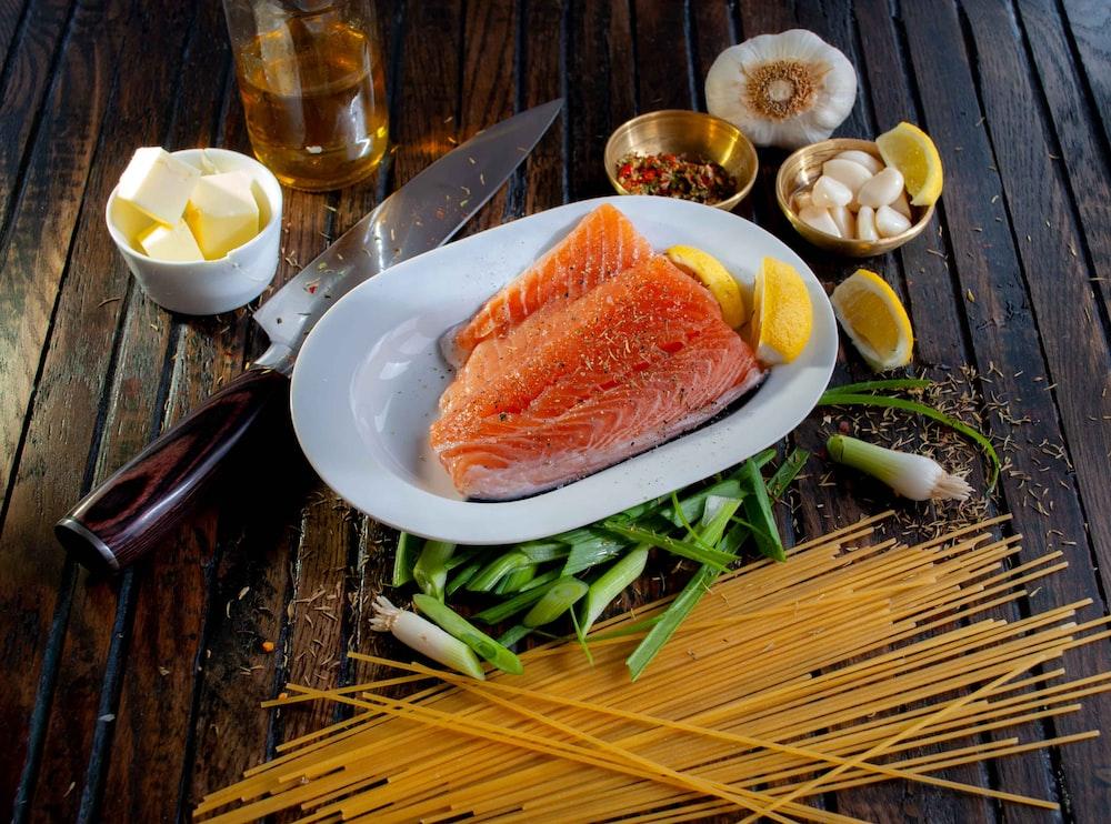 steamed salmon beside sliced of lemon