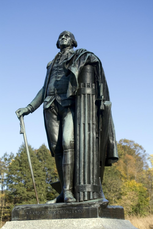 man concrete statue