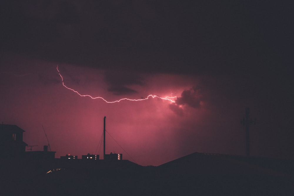 lightning during night time photo