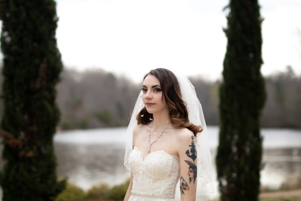 woman wearing wedding gown and veil