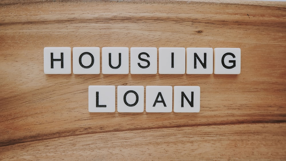 housing loan blocks on brown wooden surface