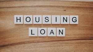 housing loan blocks on brown wooden surface