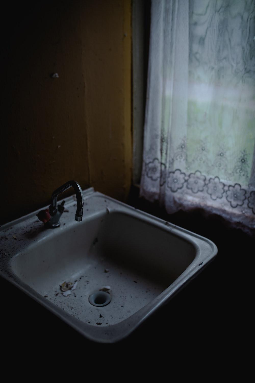 fragments in sink near window