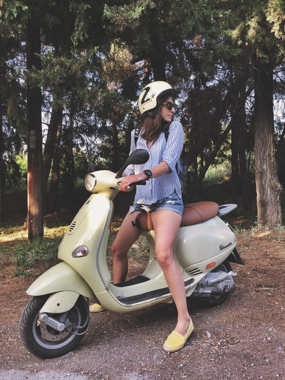 woman riding on scooter