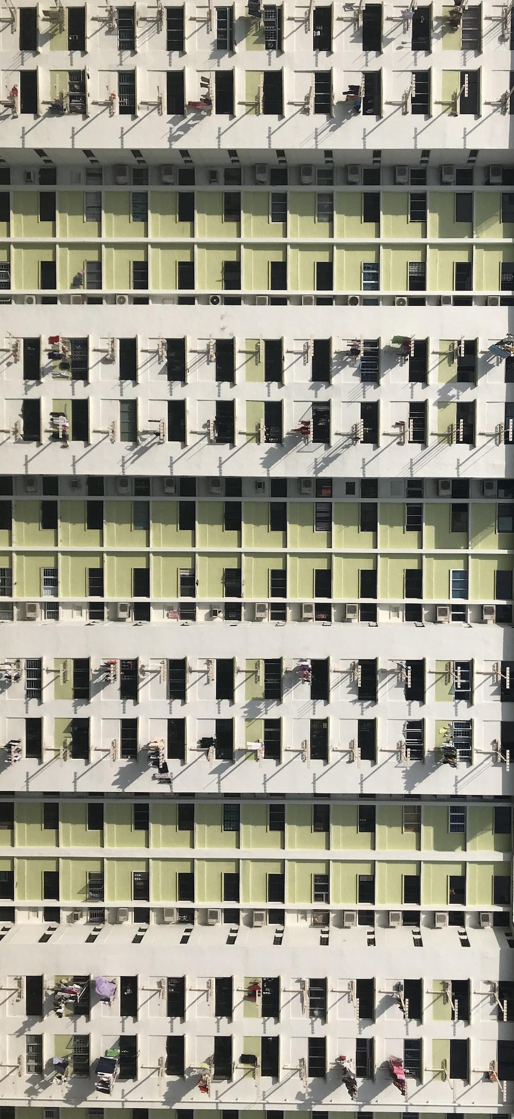 minimalist photography of high-rise building window