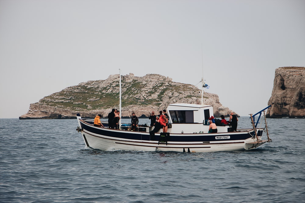 people riding in powerboat