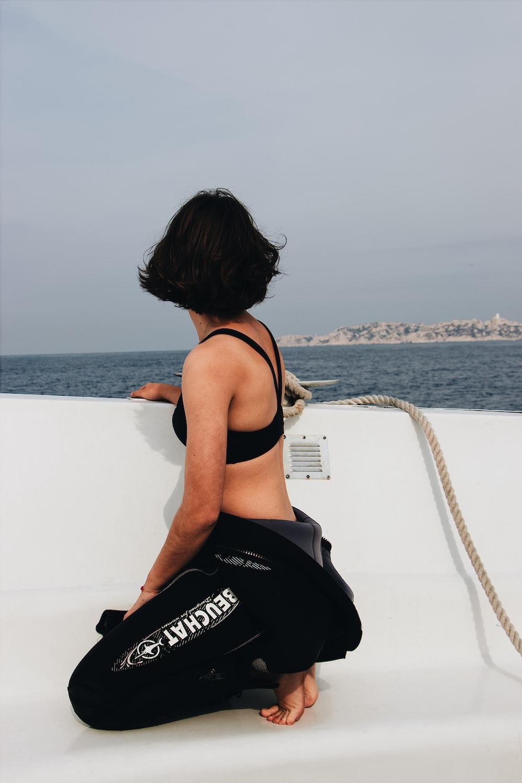 woman squat sitting on boat