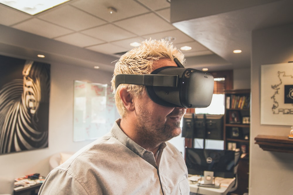 man standing and using virtual reality headset