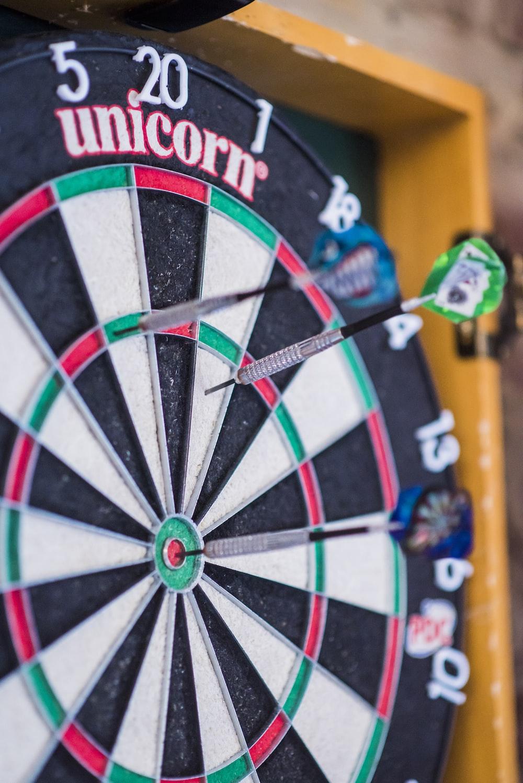 dart pins in board