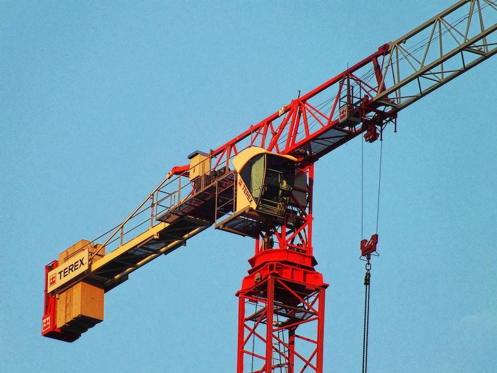 red and white metal Terex crane during daytime