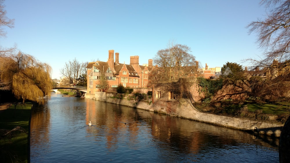 brown brick building along the river