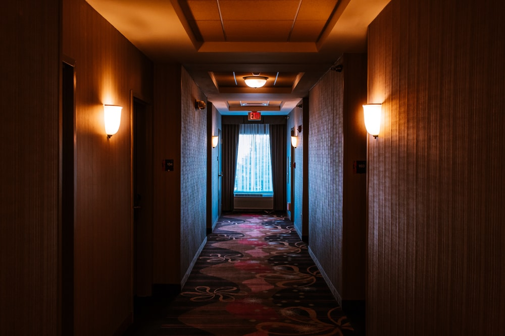 hallway of a hotel leading to a window