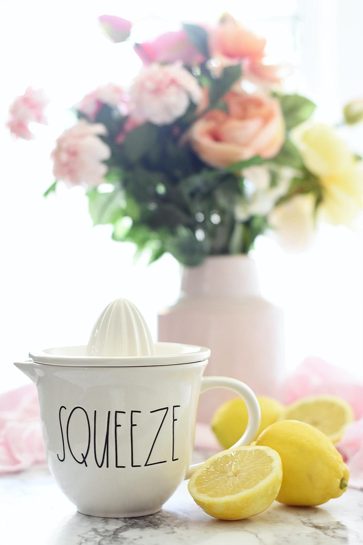 lemon beside white mug