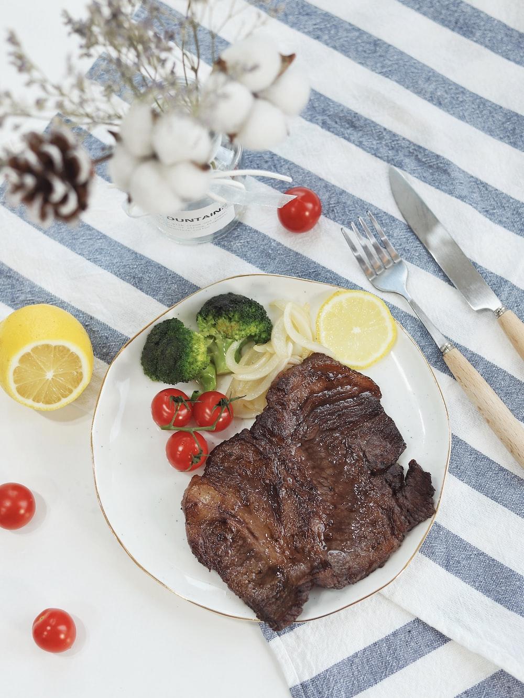 steak beside broccoli
