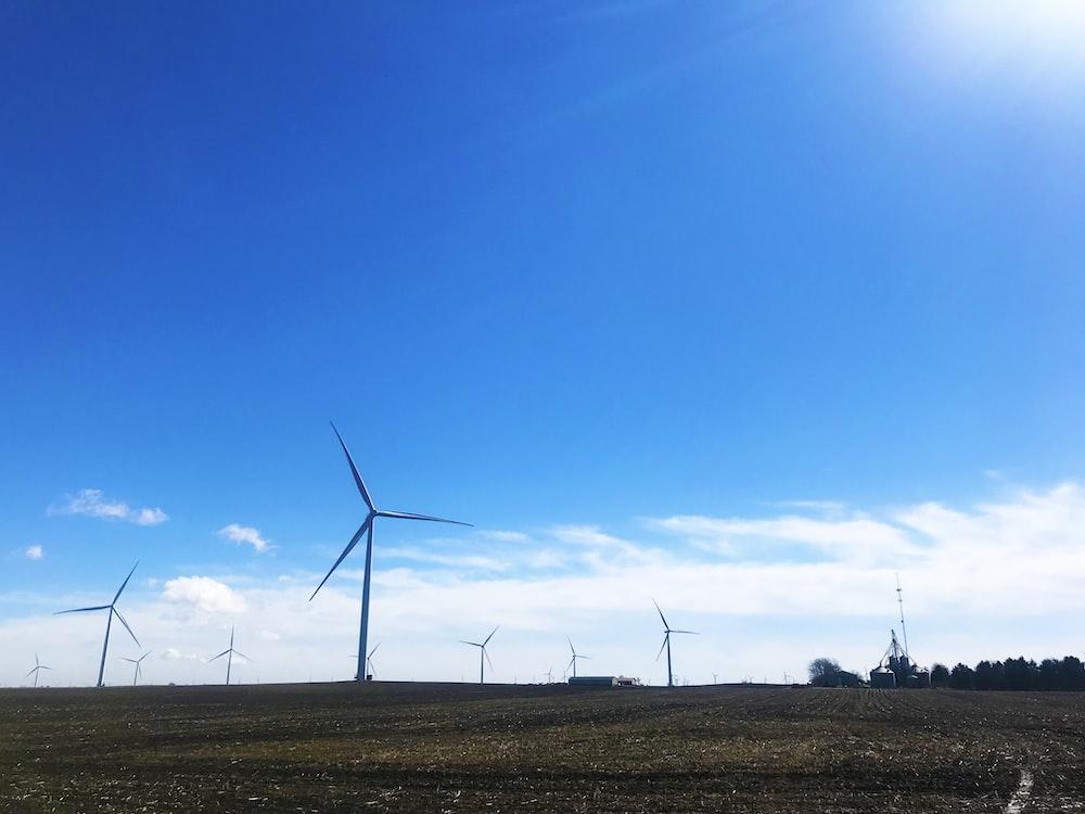 wind mills under blue sky