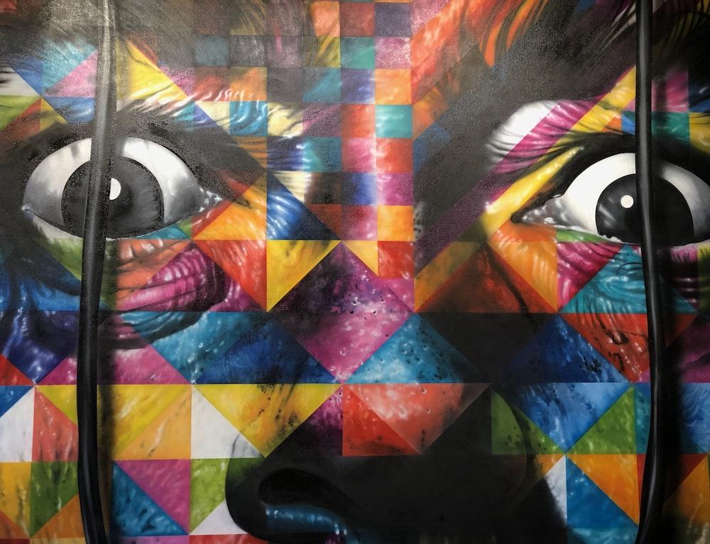 multicolored human face painting photo Free Art Image on Unsplash
