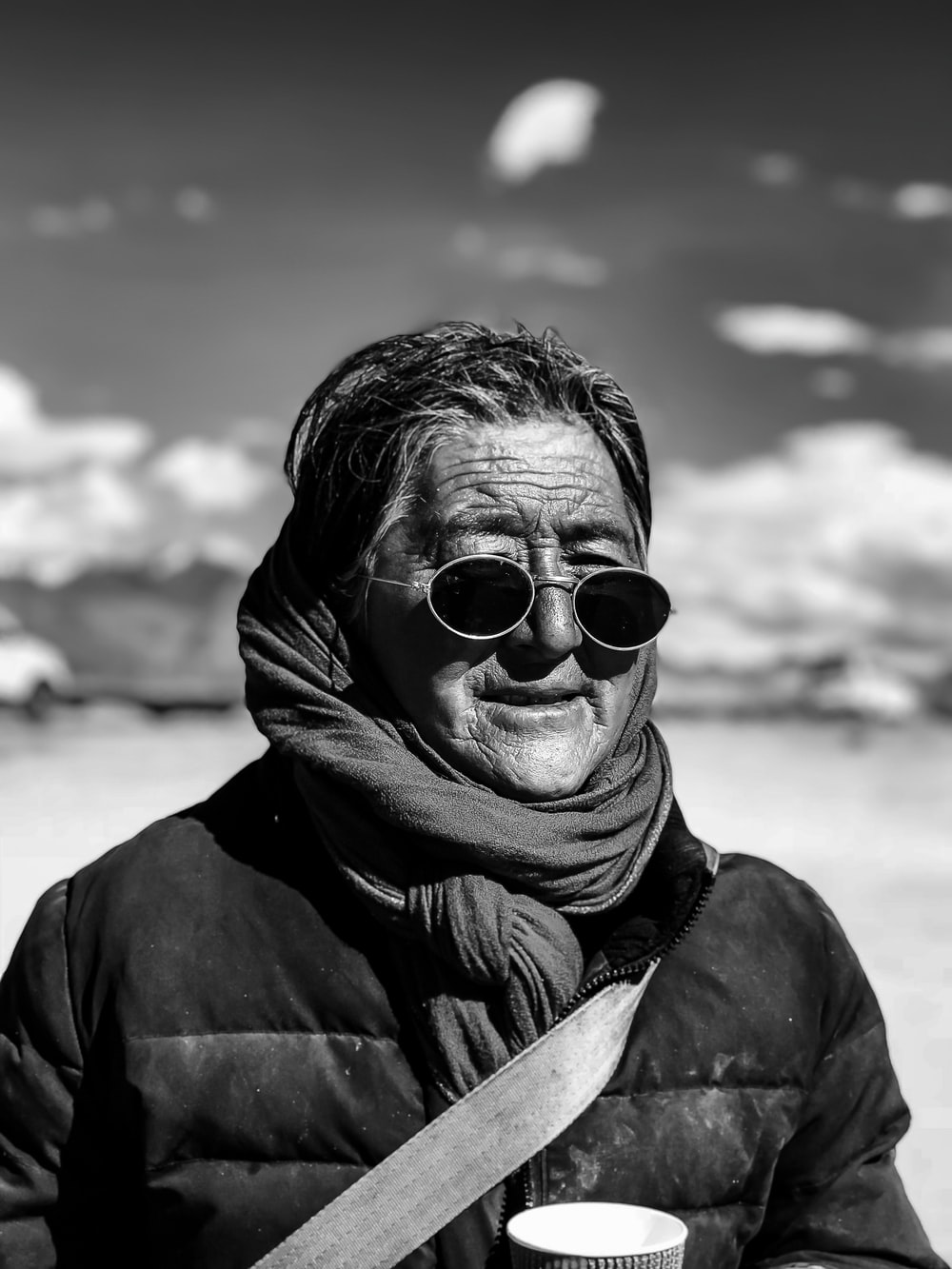 grayscale photography of woman with sunglasses