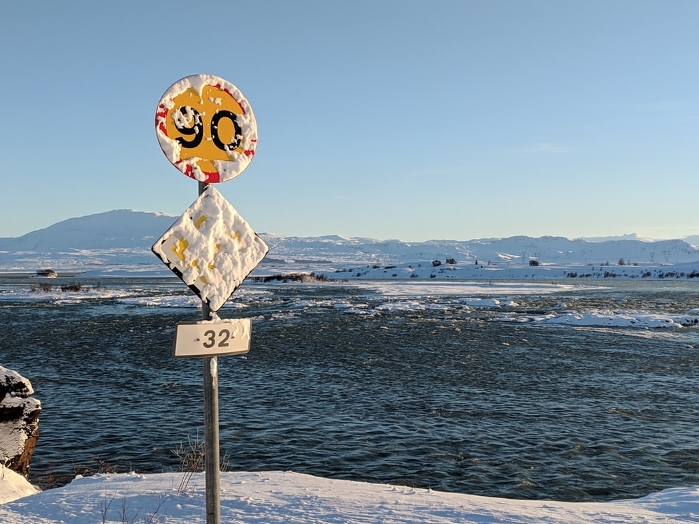 post sign on ice berg