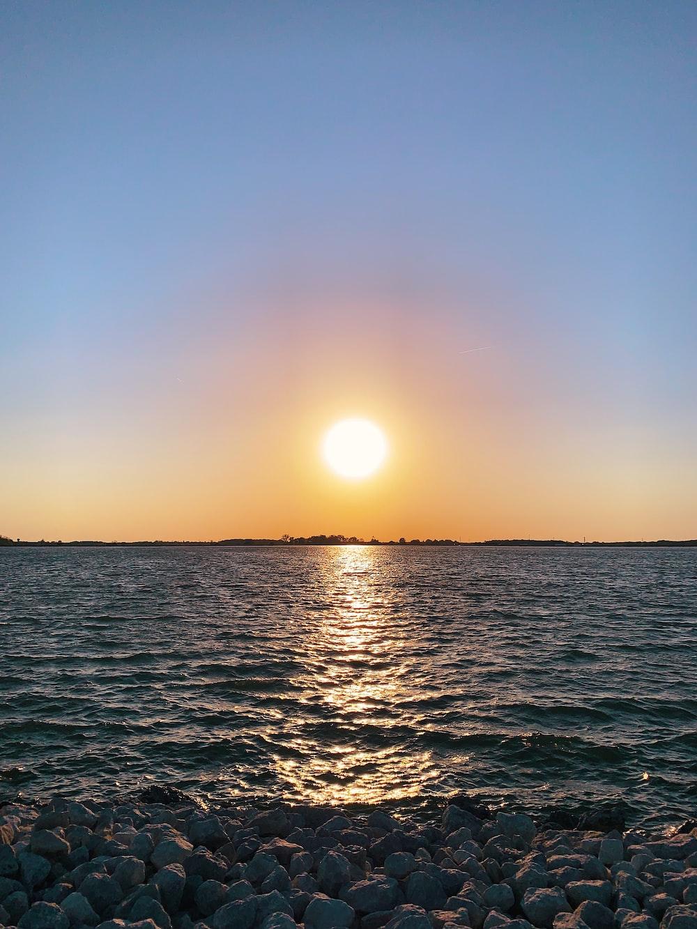 seashore under sunrise