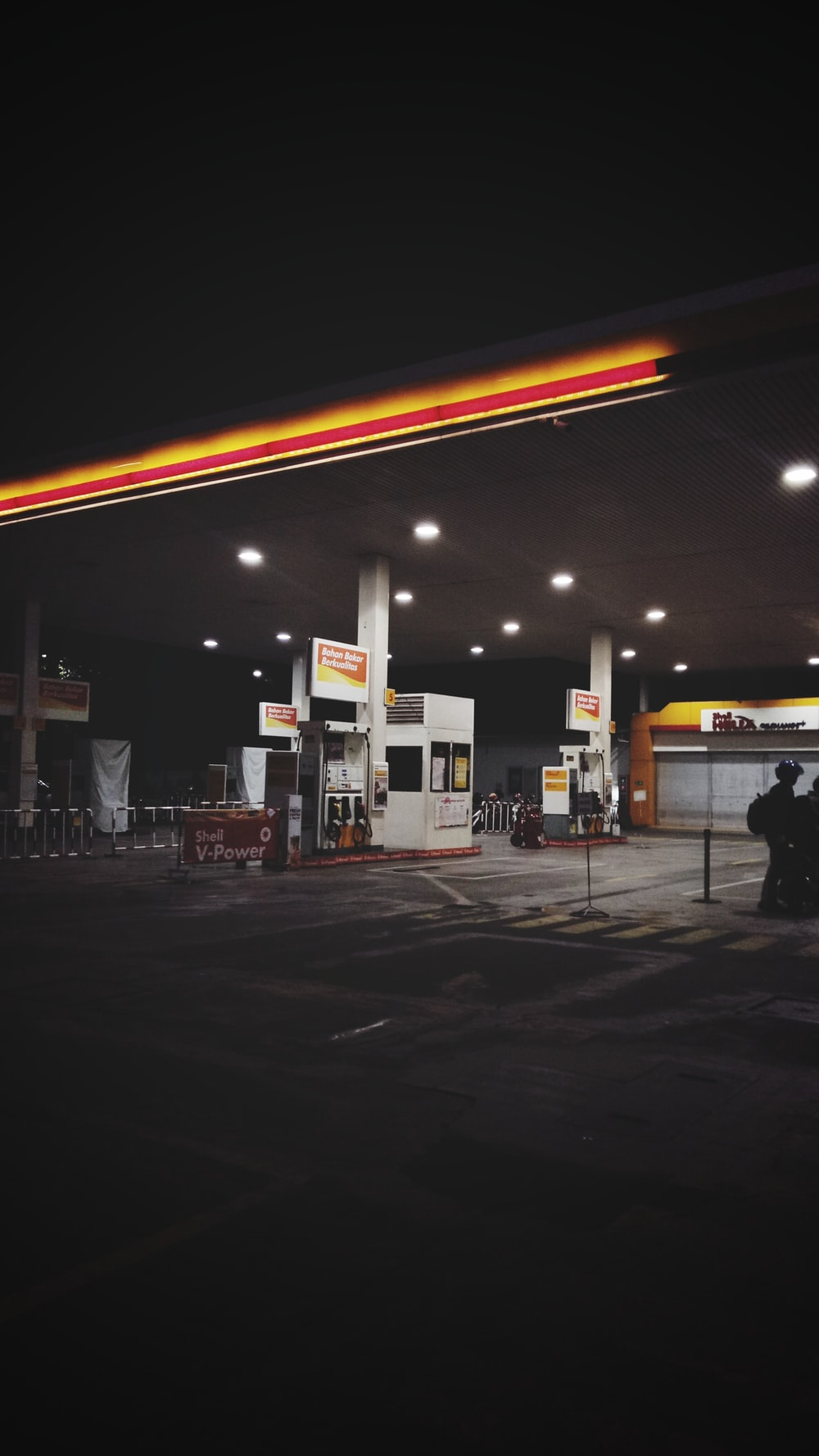 white gasoline station at night
