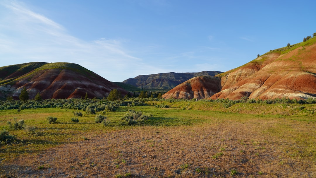 This photo was only modified slightly in order to make it fit a 4K monitor. The colors are really those colors. Painted Hills Unit at John Day National Park is one of Oregon's greatest treasures. I suggest you visit! This is part of the park that is photographed far less often than the main attraction, which lacks the green vegetation of these hills. This part, which is along the way to the main hills if you're coming from the town of Mitchell, is more breathtaking IMHO.