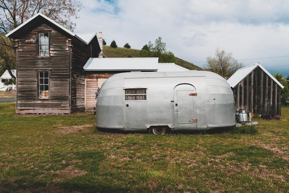 gray enclosure trailer near house