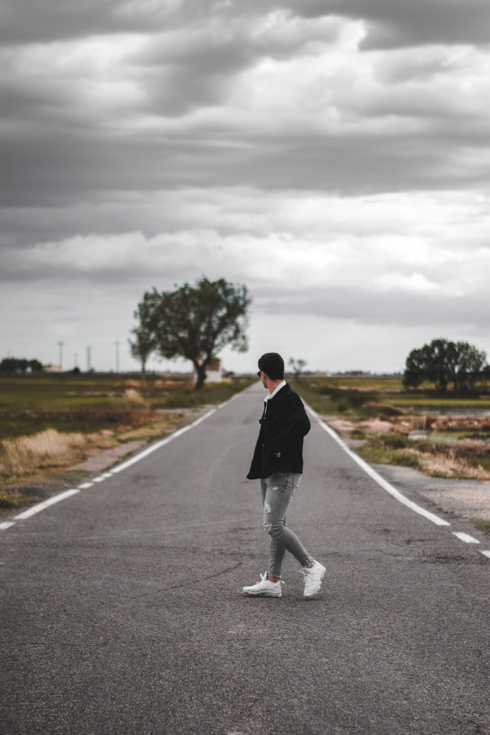 person standing on road
