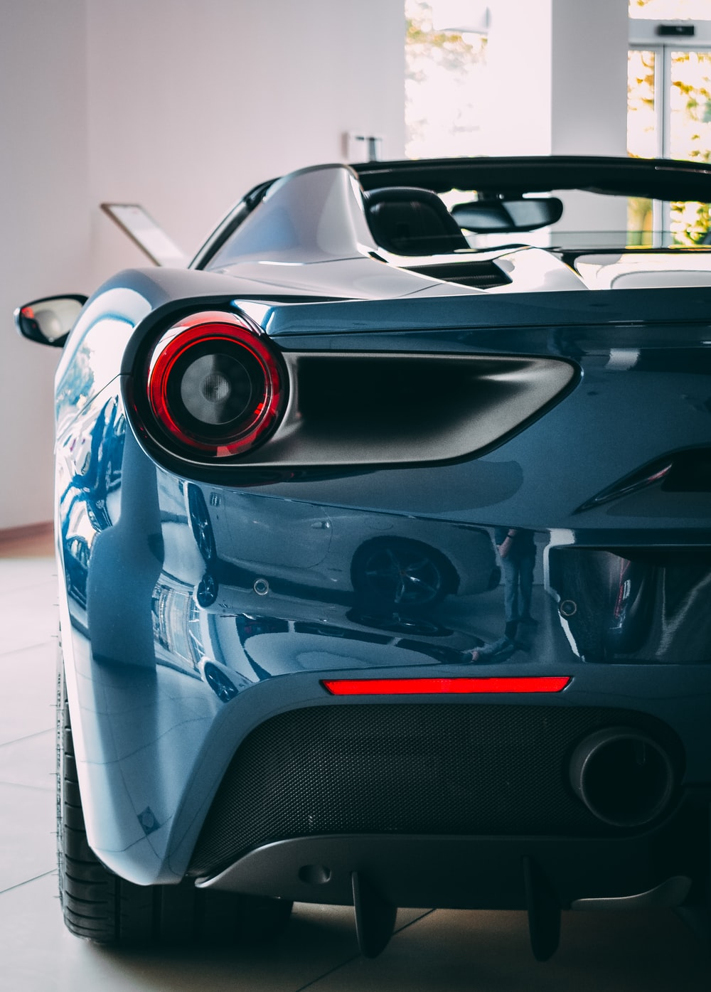 blue sports car showing taillight