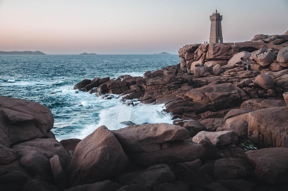 lighthouse on pile of rocks