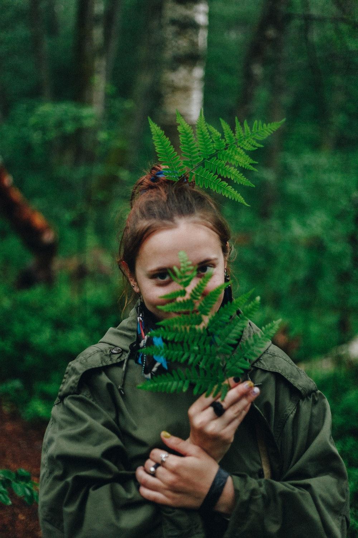 girl holding fern plant
